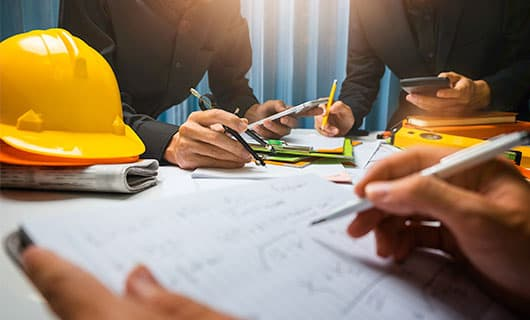 group of construction planners working at a table
